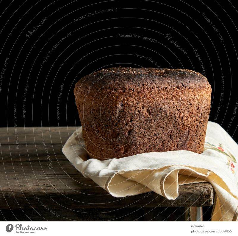 baked rye bread lies flour on a textile towel Bread Nutrition Eating Lunch Dinner Diet Table Kitchen Wood Old Dark Fresh Delicious Natural Brown Black Tradition