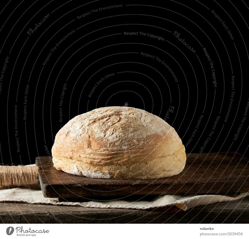 baked round white wheat bread on a textile towel Bread Roll Nutrition Eating Breakfast Dinner Table Kitchen Wood Old Dark Fresh Natural Brown Yellow Black White