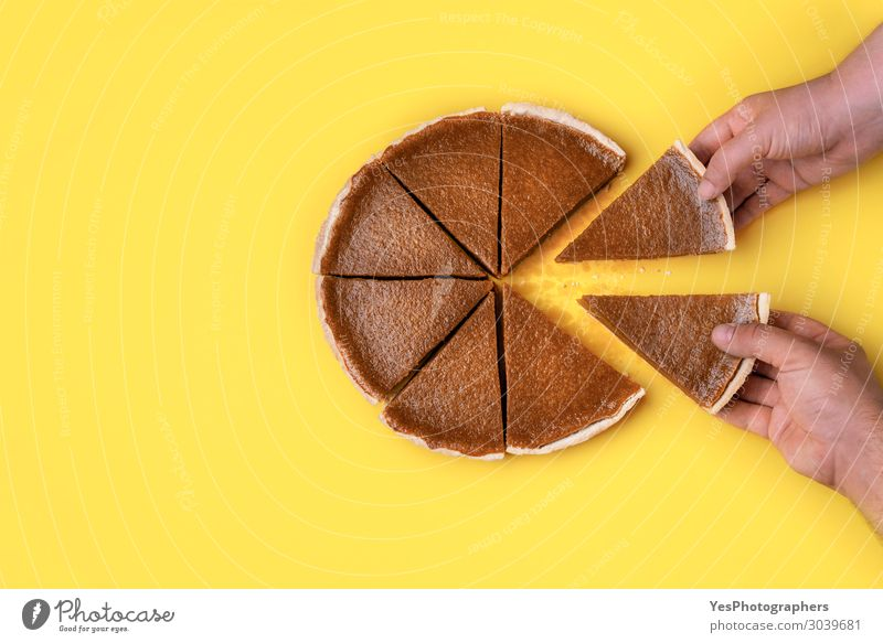 Hands taking pie slices. Eating pumpkin pie Food Cake Dessert Candy Business Autumn Brown Yellow Orange Teamwork Tradition Thanksgiving day above view American