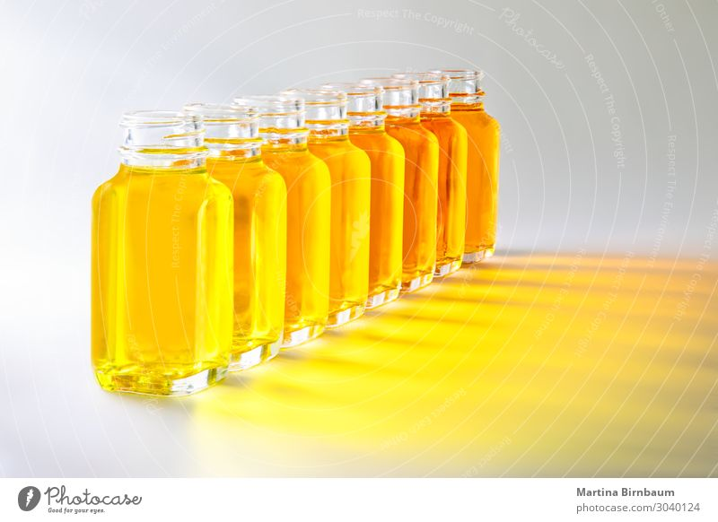 Bottles with yellow fluids in different shades of yellow White Yellow Brown Fresh Wet Vegetable Beer Transparent Refreshment Object photography