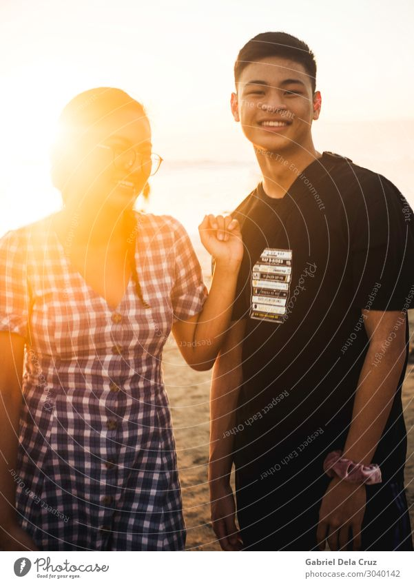 Siblings in the sunset Vacation & Travel Tourism Trip Adventure Sun Sunbathing Beach Masculine Feminine Young woman Youth (Young adults) Young man