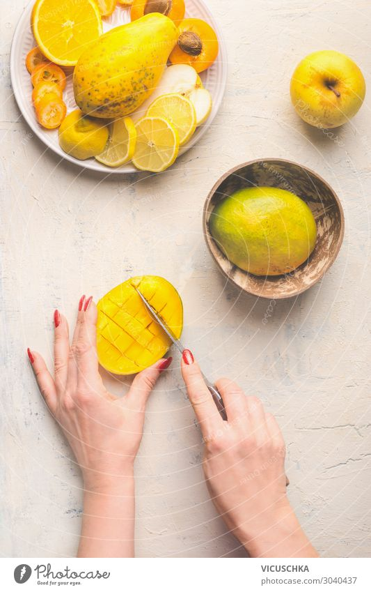 Mango preparation. Hands cut mango half in lattice pattern Food Fruit Crockery Knives Style Design Healthy Eating Cooking Kitchen Table Food photograph