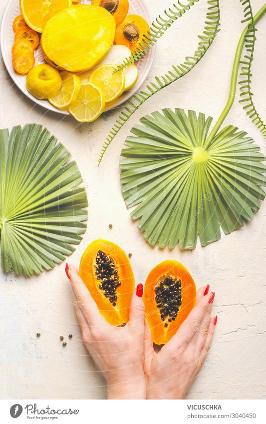 Hands holding the halved papaya Food Fruit Nutrition Breakfast Design Exotic Healthy Eating Woman Adults Hip & trendy Yellow Papaya Enzyme Papain Fruit flesh
