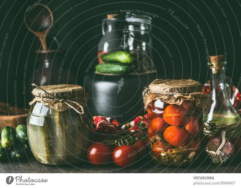Preserving of fruits and vegetables harvest. Various preserve glass jars on dark table. Healthy way of harvest storage various healthy side view copy space