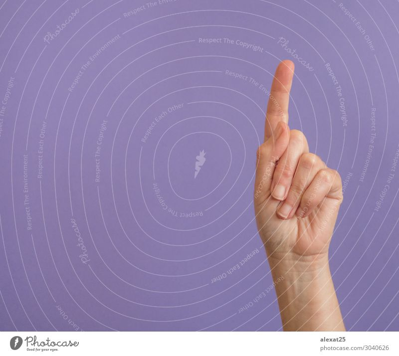 Hand with raised index finger on purple with copy space Human being Woman Adults Fingers Cool (slang) Multicoloured Violet 1 background communication