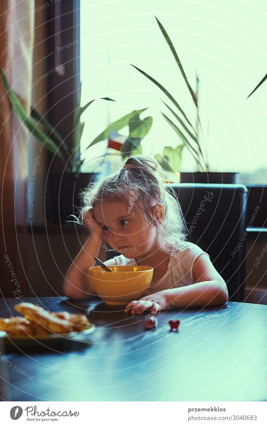 Little girl eating a breakfast Child Human being Girl Eating Lifestyle Natural Family & Relations Small Think Infancy Sit Table Authentic Cute Breakfast Home