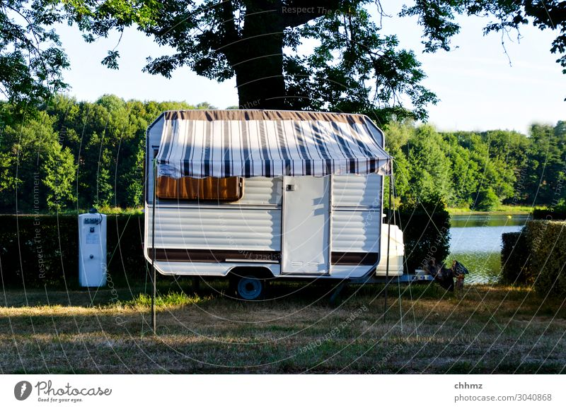 Living by the lake Caravan Camping Vacation & Travel Deserted Camping site rural Lake Colour photo Leisure and hobbies Summer Nature Freedom Shadow Idyll