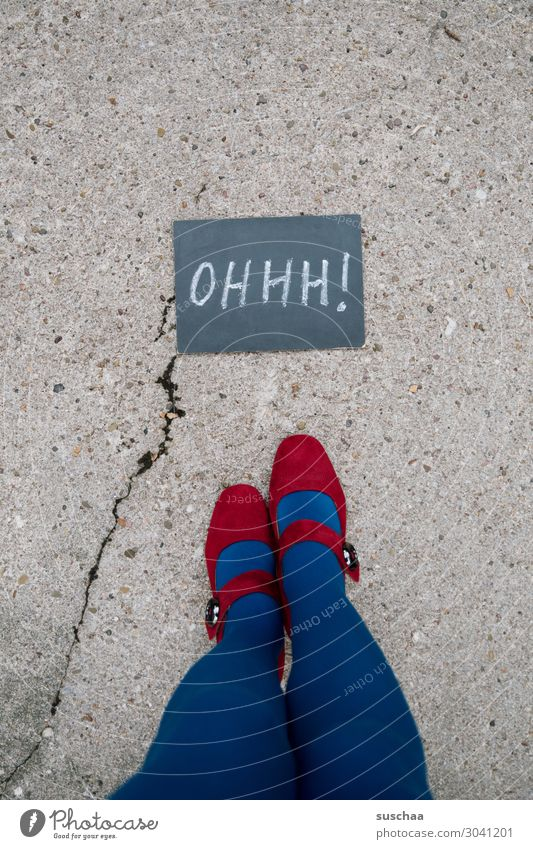 Woman Young woman Blue Red Street Legs Feet Characters Letters (alphabet) Asphalt Surprise Blackboard Crack & Rip & Tear Stockings Whimsical Strange