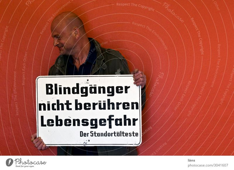 Human being Adults Life Wall (building) Wall (barrier) Masculine Characters 45 - 60 years Signs and labeling Signage Hamburg Threat Digits and numbers Risk