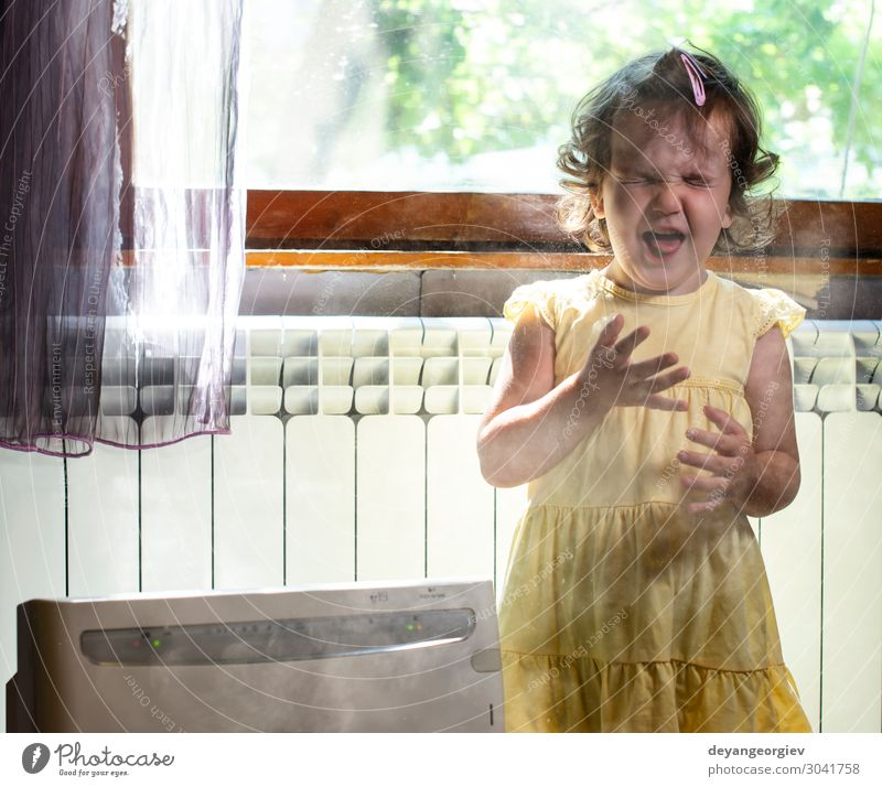 Little girl in a dusty room. Air purifier and coughing kid. Health care Child Infancy Earth Fresh Clean alergy allergen fine dust Sneezing sternutation air Home