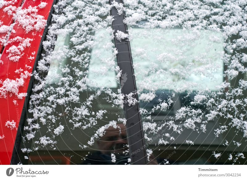 Undercover in winter Human being 1 60 years and older Senior citizen Winter Ice Frost Snow Parking lot Car Glass Metal Observe Looking Simple Red Black White
