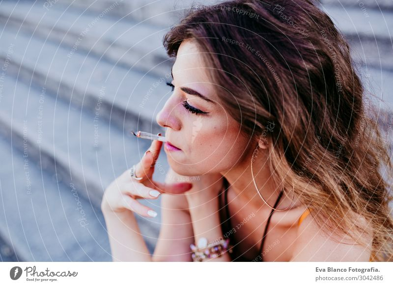 Beautiful caucasian woman smoking cigarette.Urban lifestyle Woman Human being Vacation & Travel Youth (Young adults) Young woman Summer Town Eroticism Joy
