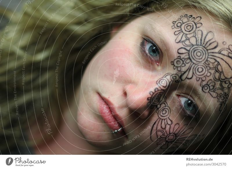 Woman with painted face Creativity Art Culture Tattoo Blonde Painted Exceptional Moody Piercing Young woman Adults Exotic Free Hip & trendy naturally Emotions