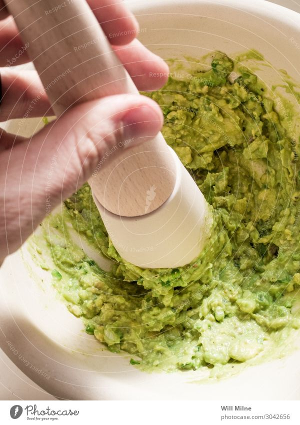 Making Guacamole Avocado Food Healthy Eating Dish Food photograph guacamole Mexicans Mortar Smash Stir Make Green Tool Cooking Kitchen Dinner