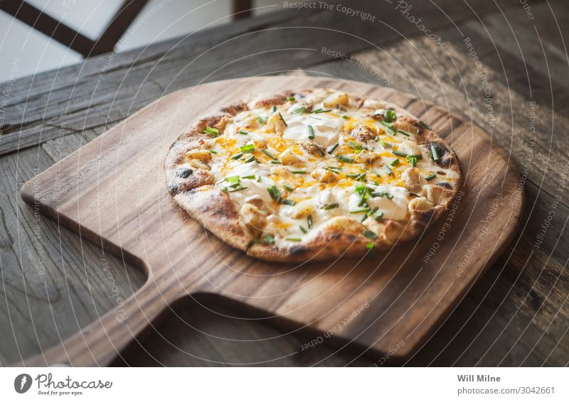 A freshly baked pizza on a wooden tray. Food Cheese Dough Baked goods Eating Lunch Fast food Italian Food Pizza Restaurant Fresh Baked dish Stove & Oven