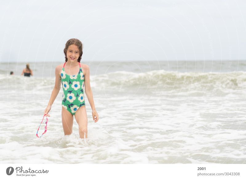 Girl Swimming with Goggles Beach vacation Swimming & Bathing Ocean Youth (Young adults) 1 Human being 3 - 8 years Child Infancy Summer Warmth Waves