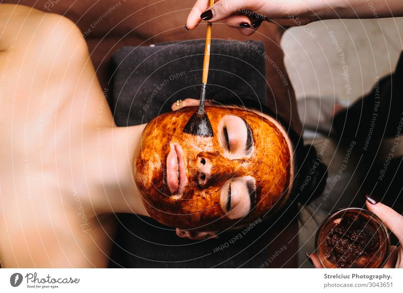 Woman doing chocolate face mask Luxury Beautiful Skin Face Health care Medical treatment Relaxation Spa Human being Adults Hand Fashion Clean Brown White Pure