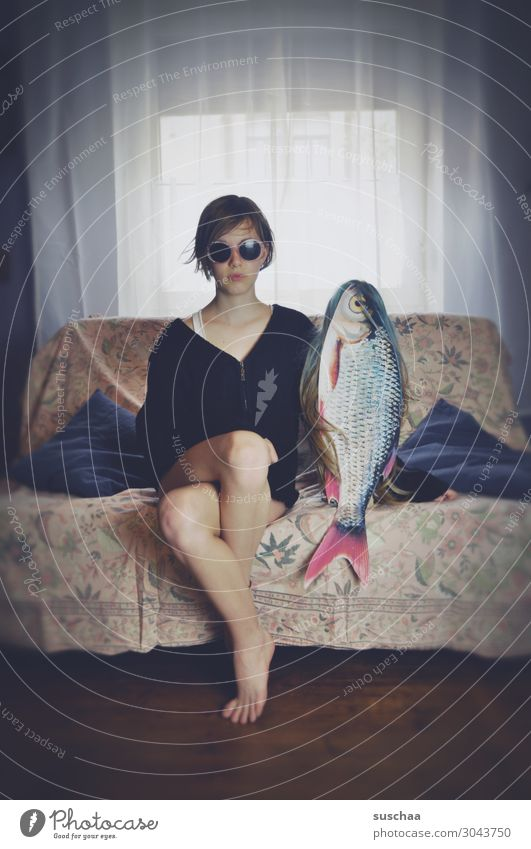my friend the fish (2) Young woman Woman Girl teenager Youth (Young adults) Puberty Hair and hairstyles Wig Living or residing Flat (apartment) Sofa Legs Date