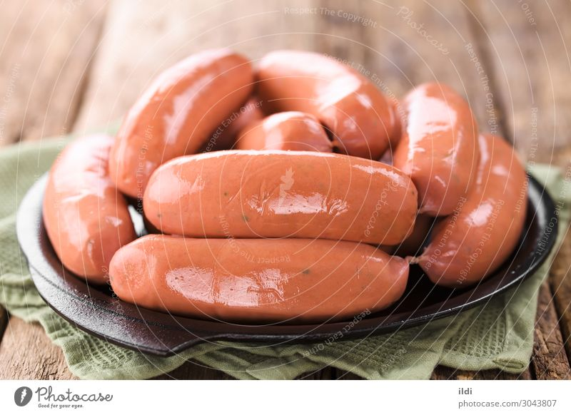 Sausage or Bratwurst Meat Fresh food chorizo longaniza Ground minced Pork Beef Processed preserved bbq barbecue Cooking casing iron Cast iron Horizontal