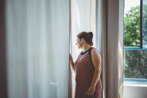 Neighbourhood I Human being Feminine Woman Adults Window Looking Curiosity Know Living or residing Neighbor Curtain Mistrust Copy Space left Colour photo
