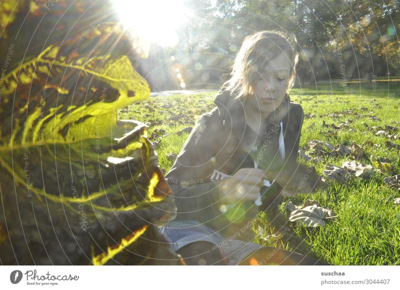 girl on an autumn meadow with leaf left Child Youth (Young adults) teenager Meadow Sun Sunlight Sunbeam Autumn foliage Fall meadow Nature Season Autumnal leaves
