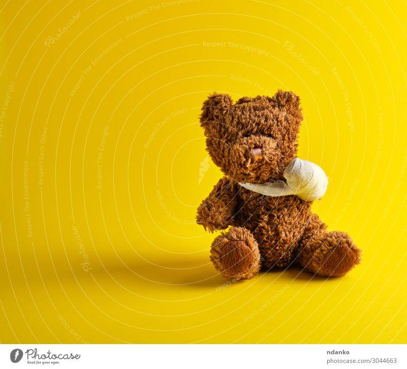 brown teddy bear with a bandaged paw sitting Joy Medical treatment Illness Medication Child Hospital Infancy Toys Doll Teddy bear Sit Small Funny Cute Soft