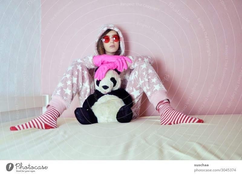teenager with pink rubber gloves sits on her bed with her cuddly toy and pink sunglasses on Youth (Young adults) Young woman youthful Infancy Goofy Crazy Daft