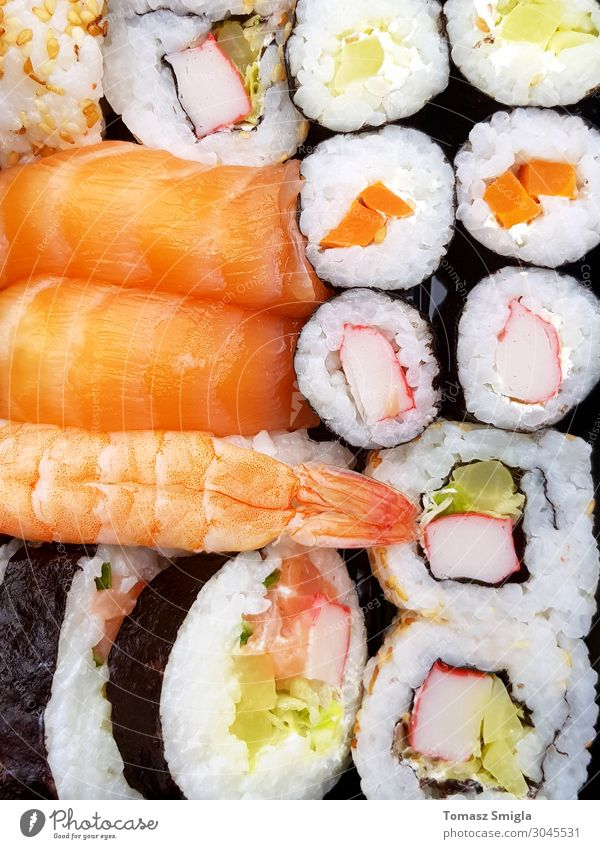Fresh delicious well made sushi rolls seen from above Fish Seafood Lunch Dinner Diet Sushi Plate Restaurant Culture Pack Delicious Above Juicy White Tradition