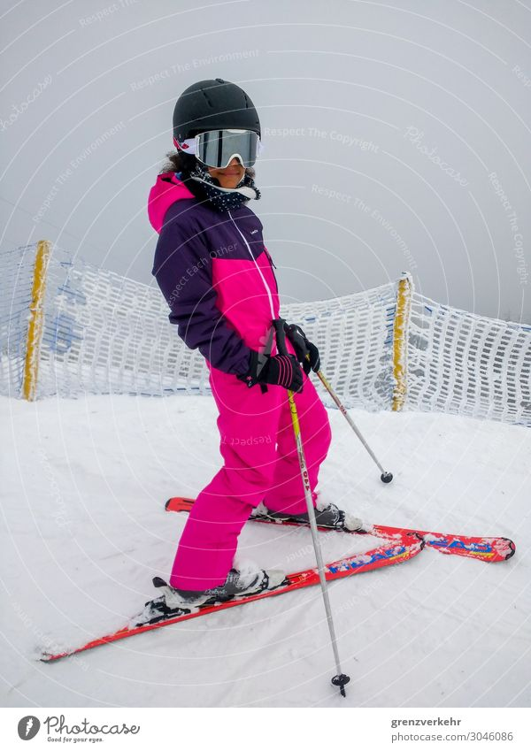 shut down Snow Winter vacation Skiing Ski suit Skis Ski pole Skiing helmet Skier Downhill race Ski run Human being Feminine Girl 1 8 - 13 years Child Infancy