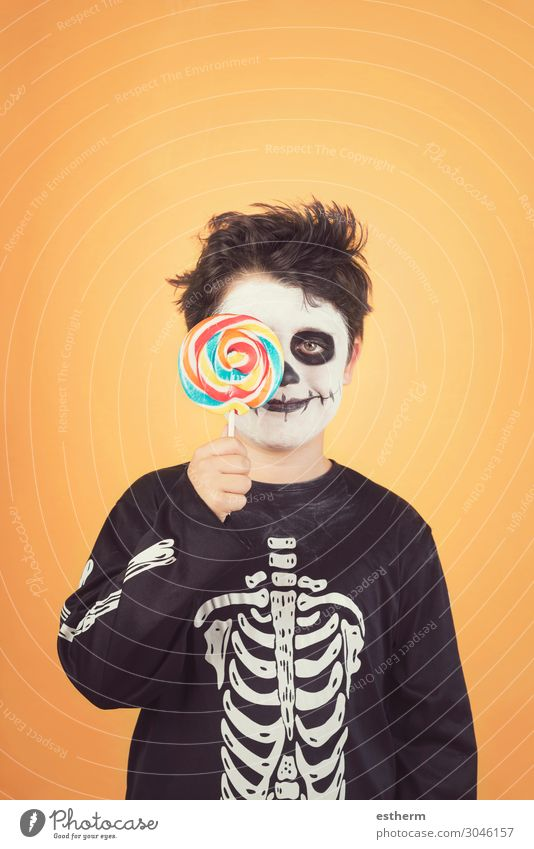 Happy Halloween.funny child in a skeleton costume Eating Joy Medical treatment Feasts & Celebrations Hallowe'en Child Infancy Autumn Smiling Dark Happiness Cute