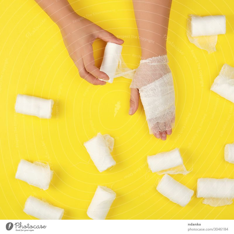 right hand wrapped with white gauze bandage Woman Human being White Hand Adults Yellow Health care Body Arm Fingers Clean Protection Illness Medication Pain