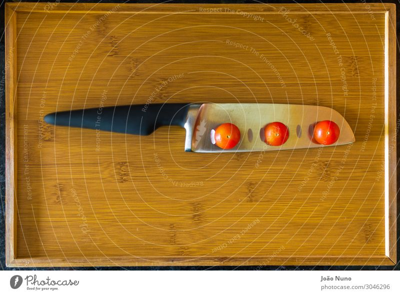 Balancing Cherry Tomatoes Over Chef's Knife Vegetable Lettuce Salad Nutrition Lunch Dinner Organic produce Vegetarian diet Diet Cutlery Fork Metal Steel Balance