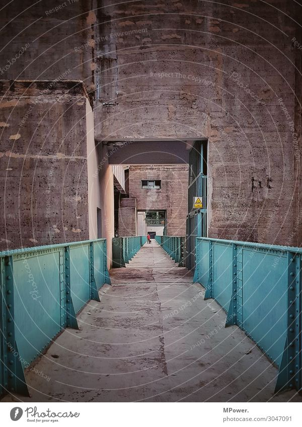 on the dam. Technology Human being 1 Old Concrete Steel Manmade structures Retaining wall Industry Gloomy Lanes & trails Passage Colour photo Exterior shot