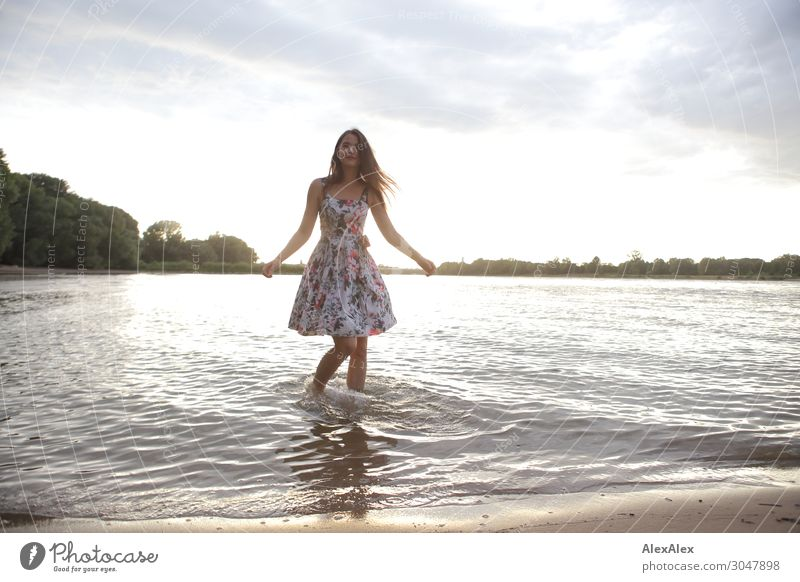 Young woman in the Rhine Lifestyle Style Joy Beautiful Wellness Youth (Young adults) 18 - 30 years Adults Landscape Water Summer Beautiful weather Tree