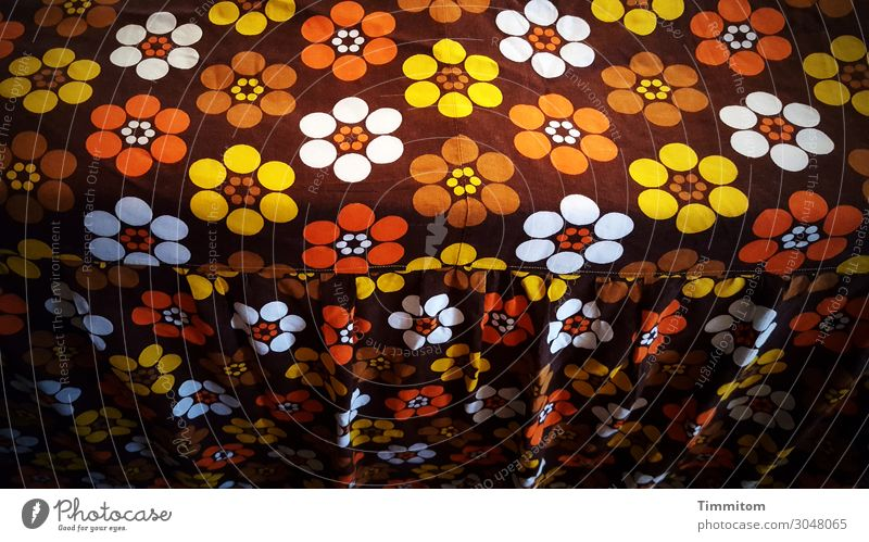 I get so flowery... Vacation & Travel Living or residing Bed Bedroom Kitsch Brown Yellow Orange Red White Emotions Surprise bedspread Wrinkles Old Colour photo