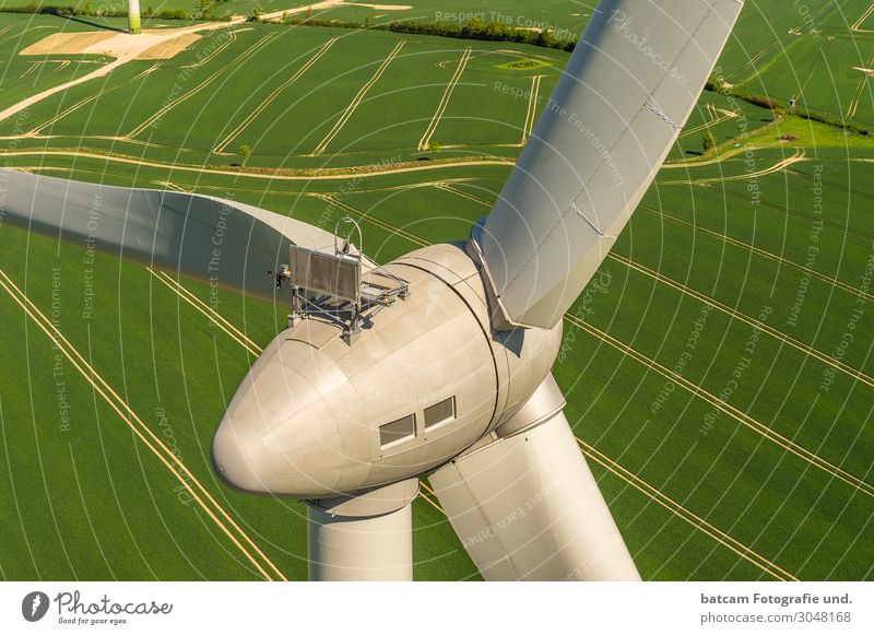 Wind turbine aerial view on green field Machinery Technology Energy industry Renewable energy Wind energy plant Modern Yellow Gray Green Windmill Enercon