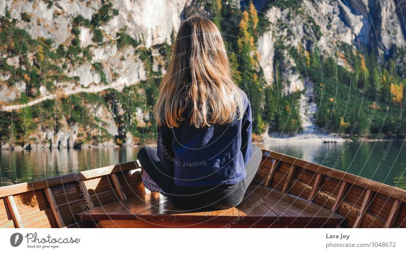 Girl from behind in wooden boat on mountain lake Vacation & Travel Trip Adventure Far-off places Expedition Mountain Hiking Feminine Young woman