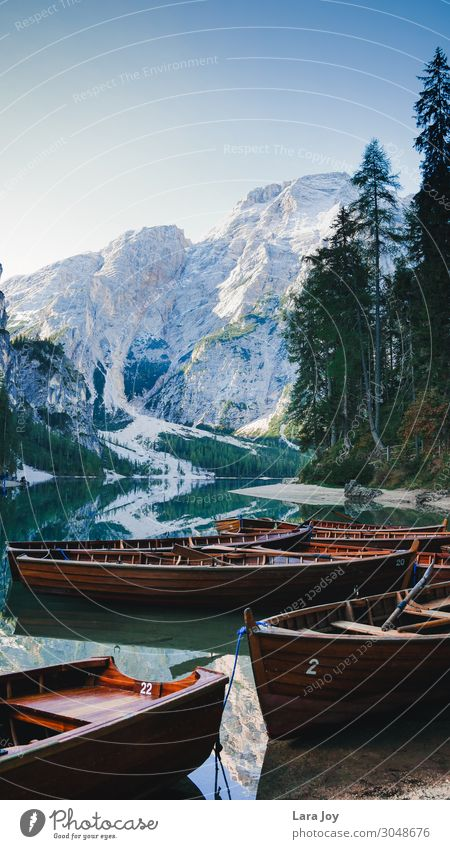 Wooden boats on beautiful mountain lake Vacation & Travel Tourism Trip Adventure Far-off places Freedom Sightseeing Expedition Mountain Hiking Water Sky
