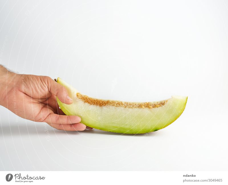 male hand holds a piece of ripe melon with seeds Nature Summer Plant Green White Hand Eating Yellow Natural Fruit Nutrition Fresh Vegetable Dessert