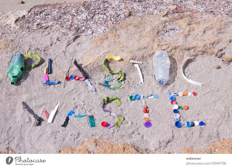 plastic waste Beach Ocean Environment Nature Sand Water Coast Mediterranean sea Plastic packaging Authentic Dirty Multicoloured Plastic waste Trash Word writing