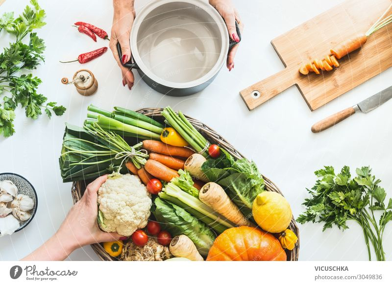 Female hands prepare various colorful organic farm vegetables Food Vegetable Nutrition Organic produce Vegetarian diet Diet Crockery Shopping Design