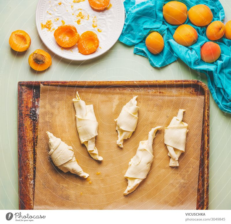 Rolled dough on baking tray. Apricot Croissants Food Fruit Nutrition Breakfast Crockery Design Living or residing Style Baked goods Baking tray Food photograph