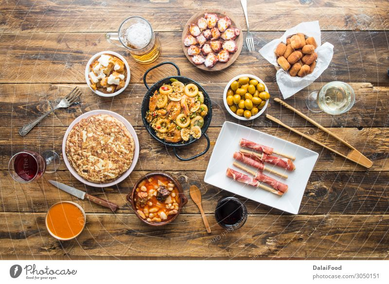 Typical spanish food Meat Seafood Cheese Bread Soup Stew Nutrition Lunch Dinner Beer Table Restaurant Wood Fresh Delicious Above Black White Tradition