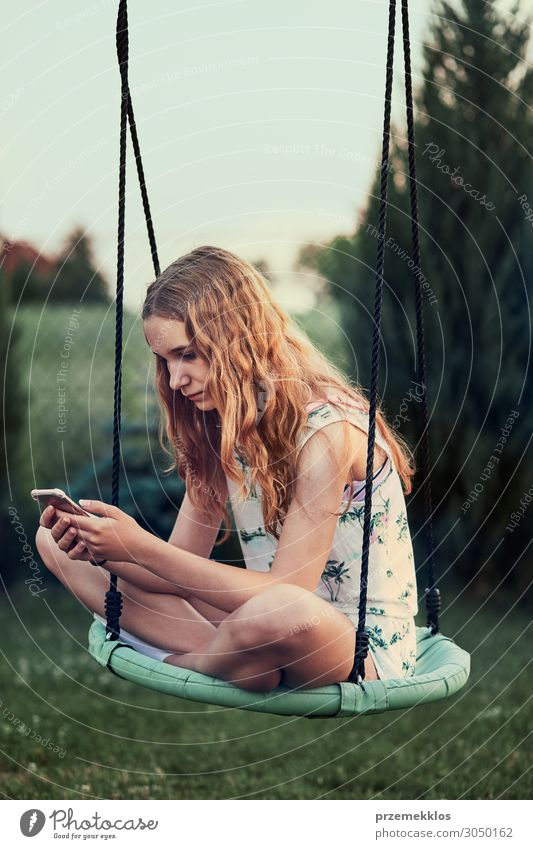 Young woman using mobile phone smartphone Woman Human being Youth (Young adults) Summer Adults Garden Copy Space 13 - 18 years Modern Technology Sit Action