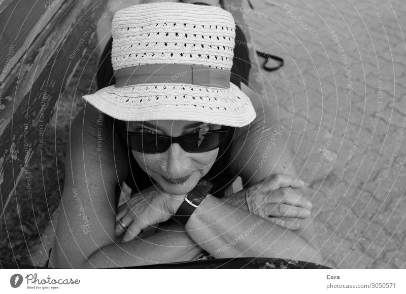 holiday happiness Calm Summer vacation Sun Sunbathing Bench Human being Woman Adults Face 45 - 60 years Hat Sunhat Relaxation To enjoy Smiling Lie Happy