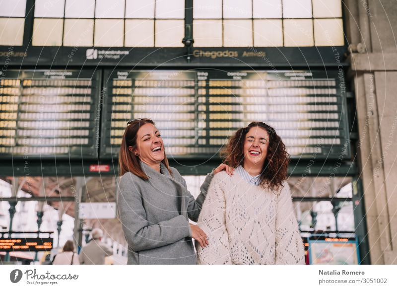 Two beautiful women laughing together at the train station Lifestyle Happy Beautiful Vacation & Travel Tourism Trip Far-off places Woman Adults Friendship