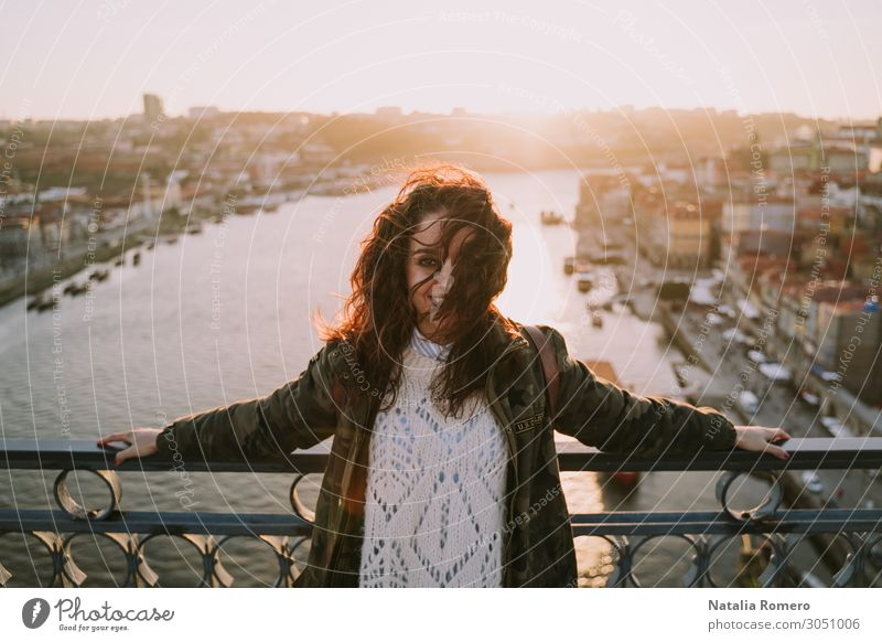 Young beautiful woman enjoying in the bridge of Porto Lifestyle Happy Beautiful Vacation & Travel Tourism Summer Sun Human being Woman Adults River Skyline