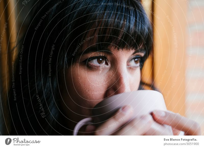 young woman at home by the window having a coffee Woman Human being Vacation & Travel Youth (Young adults) Young woman Beautiful White
