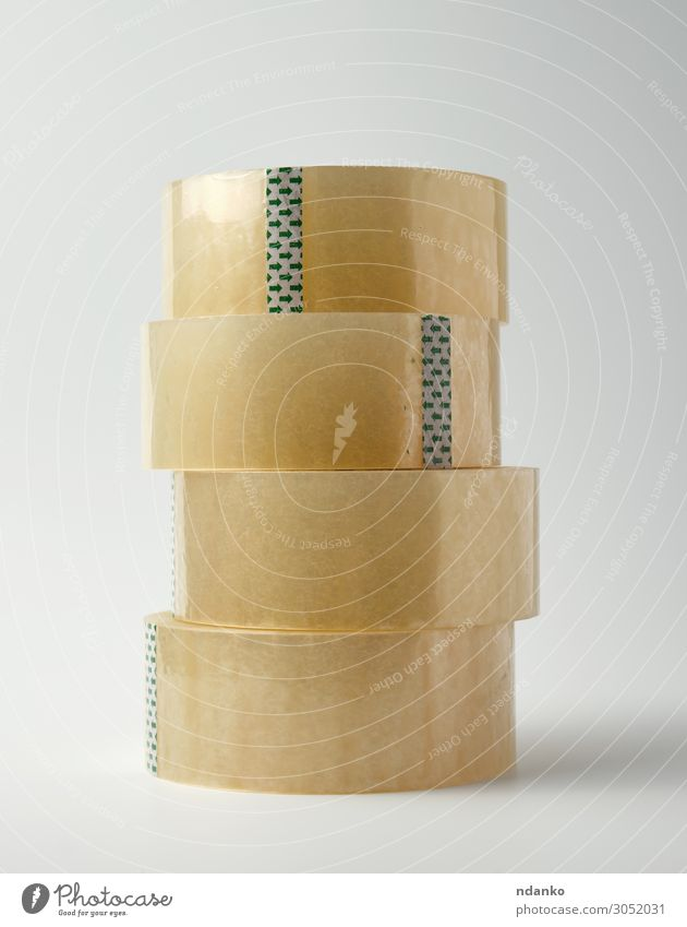 stack of transparent adhesive tape Office Tool Packaging Package Plastic Yellow White Adhesive background Bobbin circle clear Delivery equipment glue Material