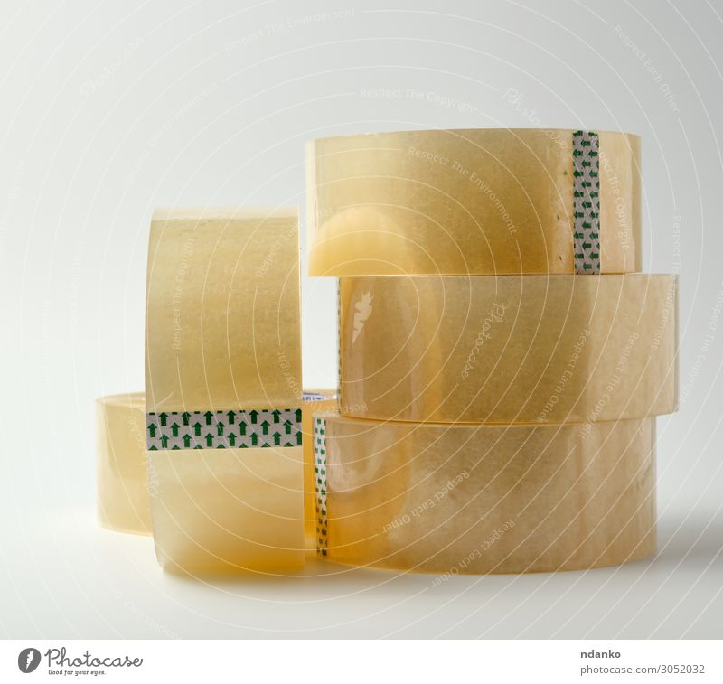 stack of transparent adhesive tape Office Tool Packaging Plastic Yellow White Material equipment Bobbin sellotape background Adhesive Object photography circle
